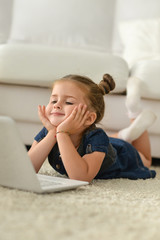 Portrait of cute little girl  with laptop