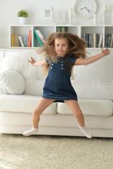 Portrait of cute little girl  jumping