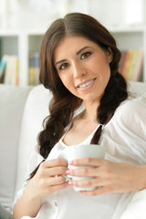 beautiful woman with a cup of tea