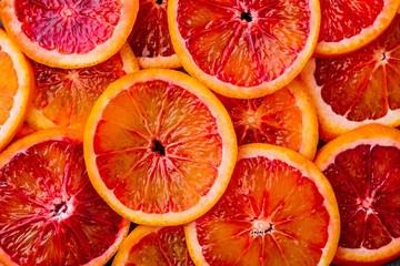 Background made of ripe juicy blood orange slices.