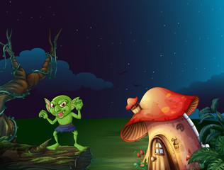Green monster by mushroom house at night
