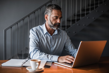 Middle-aged businessman working on his laptop.