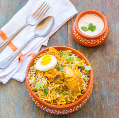 Chicken Biryani with Raita - Served in  a Clay Pot