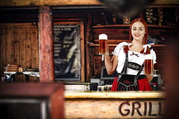 Bavarian woman and her own small business. Grill bar interior.