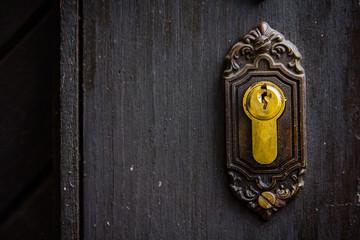 Old rusty keyhole, part of ancient door