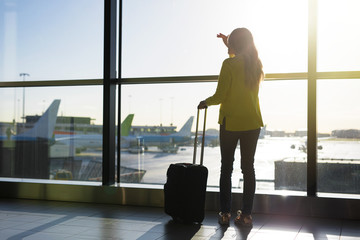 Woman standing by window in airport