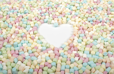 White area with heart shape in colorful marshmallow background