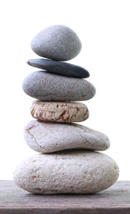 Balance Stones stacked placed on a wooden floor.