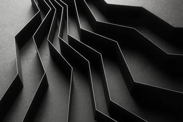 Fototapeta Abstract pattern made of black paper, dark background obraz