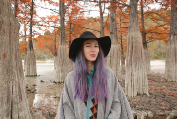 Girl in cypress trees.