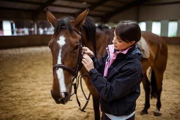 Female rider leading her horse