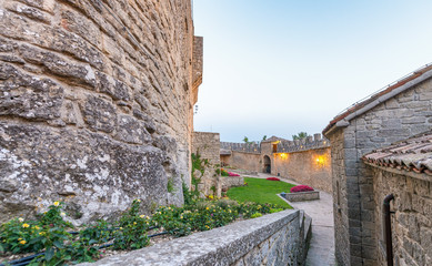 Ancient castle walls at sunset