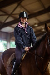 Female rider riding her horse