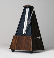 Metronome in action isolated and on a plain background