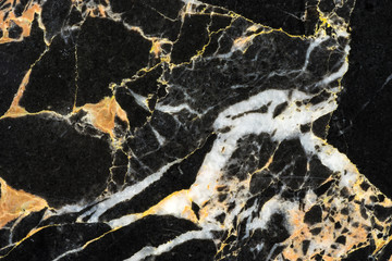 golden black marble with abstract texture pattern