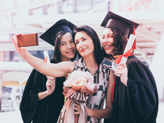 Beautiful woman congratulates for her family on graduation day, Successful concept