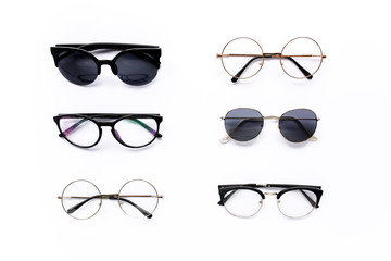 Wall Mural - Female sunglasses on white background. Flat lay, top view.