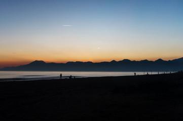 Fishers fishing at sunset at Lara Beach, Antalya, Turkey