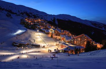The slopes of a ski resort (Meribel - Mottaret, France) in the evening.