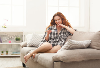Happy girl reading the results of her pregnancy test