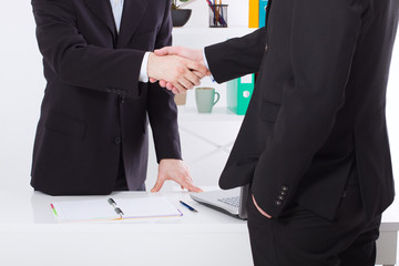 Business deal. Partnership meeting concept with successful businessmen handshaking at office background. Selective focus, copy space and horizontal. Team work and trust