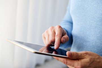 Male hand presses on screen digital tablet