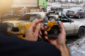 Car crash accident damaged with hand using smartphone taking