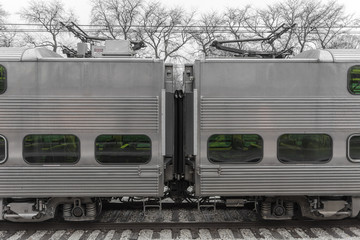 Between to train cars with bare trees