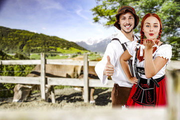 small business and two young people in bavarian clothes