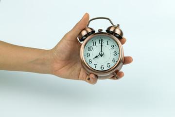 hands holding Vintage alarm clock