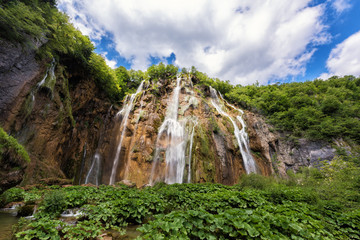 Big Waterfall (Veliki Slap) in Plitvice Lakes National park, beautiful summer landscape with blue cloudy sky, Croatia