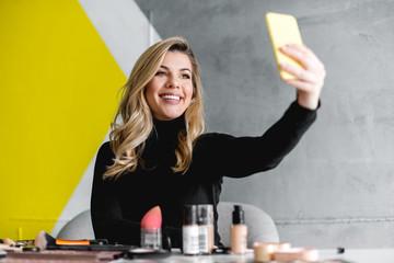 Beautiful woman making selfie