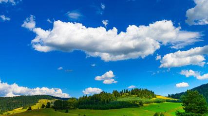 beautiful landscape with gorgeous cloudscape over the hills of Pieniny mountains