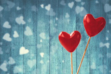 Two red hearts on blue background. Valentines Day concept. Holiday background. Copy space