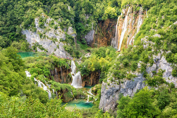 Panoramic view of waterfalls, rocks and lakes from popular tourist viewpoint in Plitvice Lakes National park. Amazing nature summer landscape, famous landmark in Croatia
