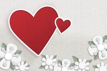 Hearts and flowers. Paper cut style illustration with two hearts and some white flowers.
