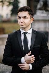 fashion portrait of a man in black suit