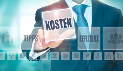 """A businessman pressing a Costs """"Kosten"""" button in German on a futuristic computer  display"""