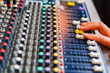 Close-up of DJ's audio mixing console