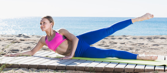 Positive healthy woman stretching muscles