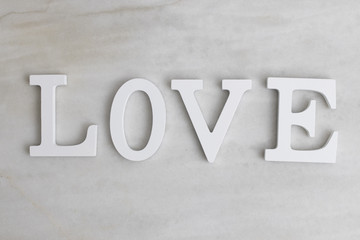 text with word love in the background of marble