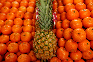 Pineapple and tangerines are seen at a shop in Budapest