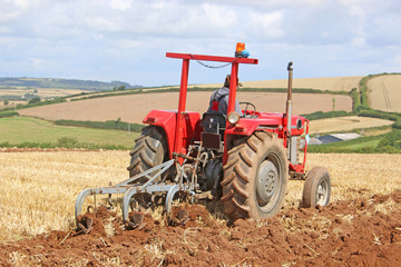Vintage tractor ploughing