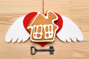 Cookies in the form of a house on wooden background