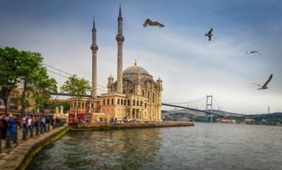 Panoramic view of the famous Ortakoy mosque (Ortakoy Camii) and Bosphorus bridge. Istanbul. Turkey.