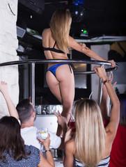 Glad adult woman dancer gogo dancing in the club