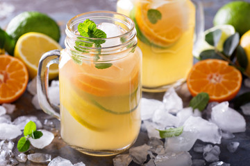 Citrus lemonade with oranges, lemons and limes