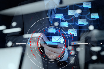 Concept of focus on target with digital diagram,graph interfaces,virtual UI screen,connections netwoork.businessman working with E-mail and smart phone