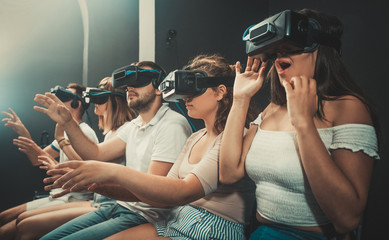 Girl watching exciting movie with VR glasses