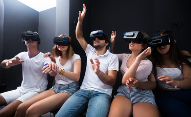 People wearing virtual reality goggles